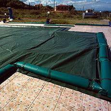 Copertura invernale con fascette senza tubolari per piscina rettangolare + scala romana - 210 g/mq